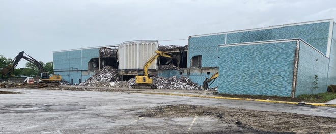 Crews from Complete Clearing Inc. work June 2 to tear down the former Macy's building, which served as the anchor business at Kingsdale Shopping Center from 1970-2015. The site is being razed to make way for a mixed-use development that will include a 95,300-square-foot community center.