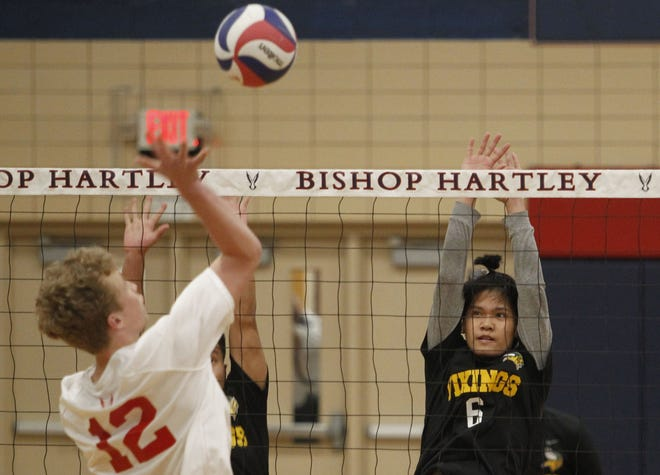 Khai Khup (right) helped the Northland boys volleyball team reach the City League championship match, which the Vikings lost 25-13, 25-22, 24-26, 25-22 at Briggs on May 25 to finish 11-8.