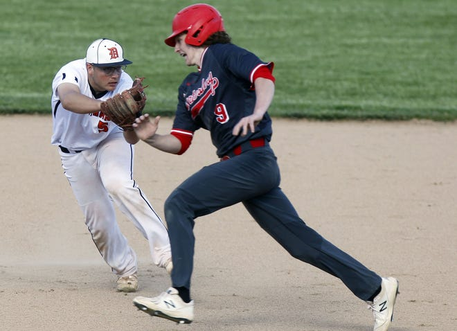 Delaware Hayes senior Nick Wildman tags out Centerburg's Reed Compton during a home game May 13. The Pacers finished 7-17 overall and 3-11 in the OCC-Capital.