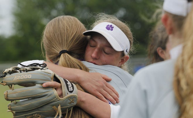 Makenzie O'Neil and Colleen Bare (facing) share a hug following Central's 13-3 loss to Watkins Memorial in a Division I regional final May 29 at Olentangy Berlin. The Tigers, who finished 20-8, won their first district title since 2013 and were seeking their first state appearance since 2007.