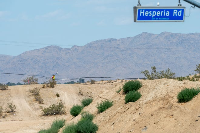 A surveyor can be seen near the intersection of Green Tree Boulevard and Hesperia Road on Wednesday, June 2, 2021. Work has officially begun on extending the boulevard, according to officials. It will add another east-west route for High Desert commuters to Interstate 15 once complete.