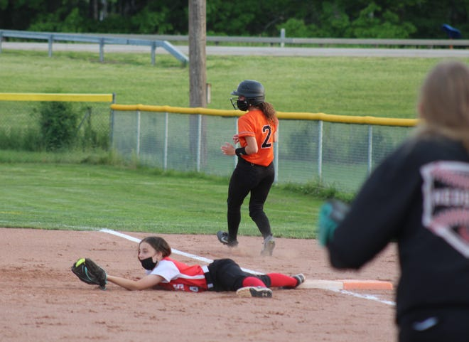 Canisteo-Greenwood second baseman Katelyn Allen stretches to make the catch while keeping her foot on the bag for an out on a sac bunt from Wellsville's Carley Young (2) Tuesday night at Tullar Field.