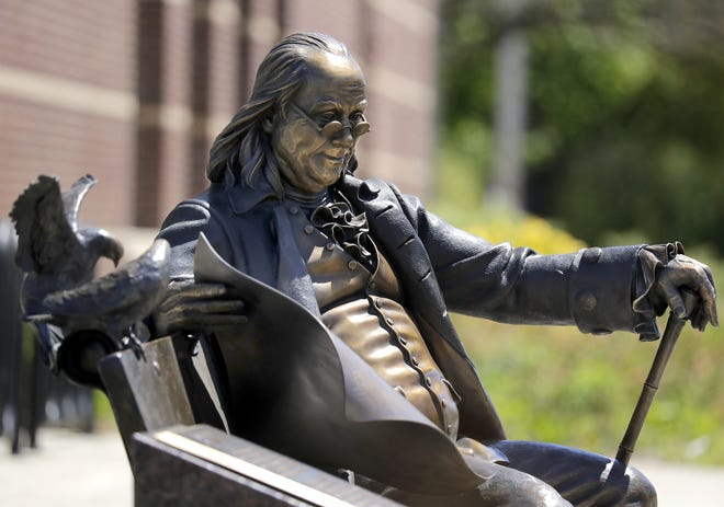 A bronze statue of Benjamin Franklin is part of Neenah's growing collection of public art. It is located at the Neenah Public Library, 240 E. Wisconsin Ave.