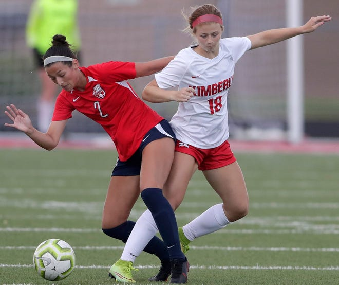 Appleton East's Ellie Behnke, left, battles with Kimberly's Alli Steeno for control of the ball during a Fox Valley Association soccer game Tuesday in Appleton.