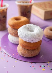 Cinnamon sugar, bare and powdered sugar doughnuts from Duck Donuts in Middletown.