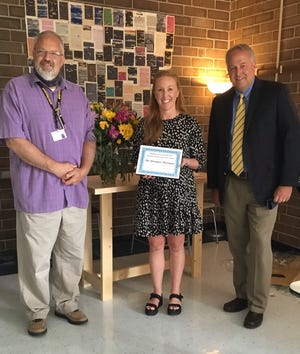 Madison High School Principal David Robinson, left, and Superintedent Will Hoffman, right, honor Madison High English teacher Meagan Morgan with this year's District Teacher of the Year award.