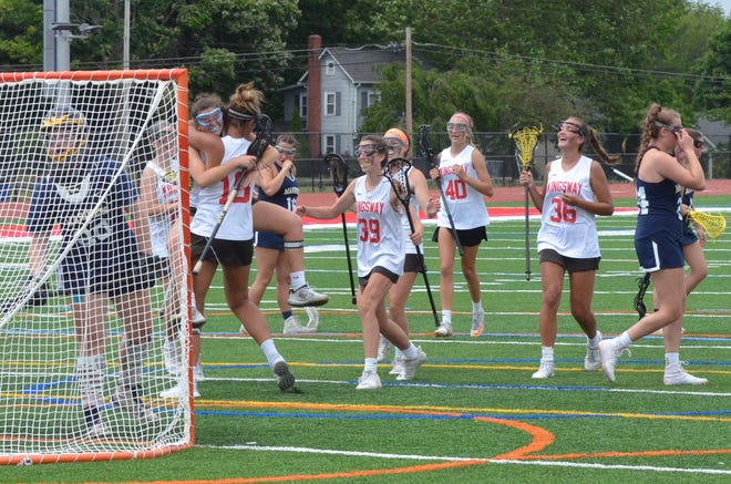 Kingsway senior Meghan Bennet jumps into Haley Phalines' arms before being mobbed by her teammates after scoring her 100th career goal