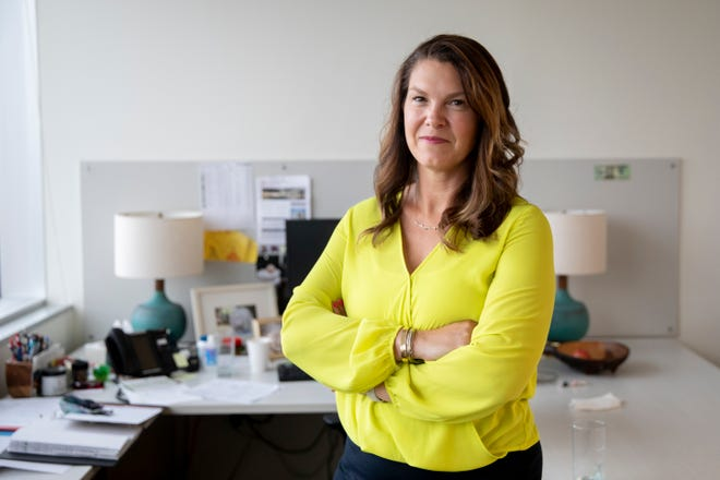 Molly North, CEO of Al. Neyer, stands inside their office building in downtown Cincinnati on Wednesday, June, 2, 2021. North has been President and CEO of Al. Neyer since 2015.