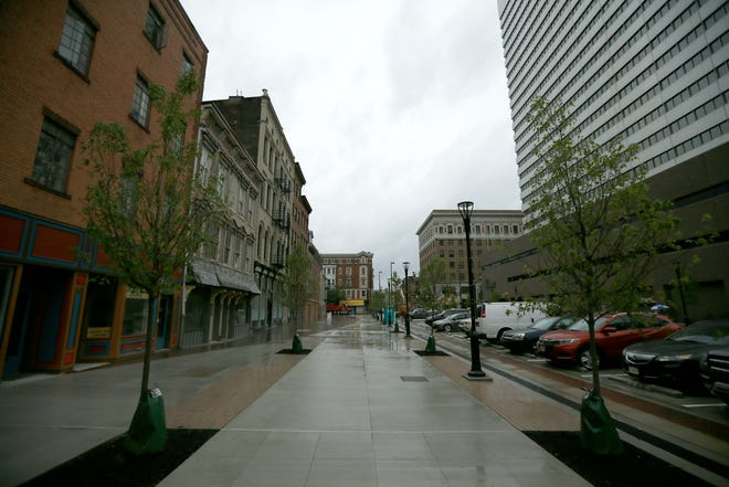 The new Court Street Plaza project nears completion as final touches and for lease signs are applied near the Hamilton County Court House on Court Street in downtown Cincinnati on Wednesday, June 2, 2021.