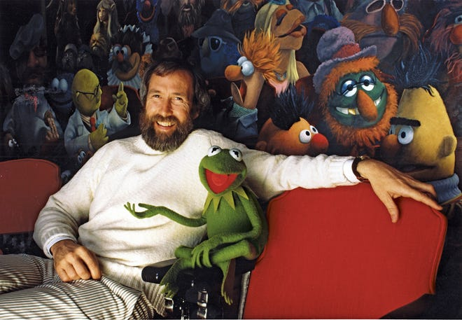 Jim Henson and his iconic creation Kermit the Frog, in front of a mural by Coulter Watt.