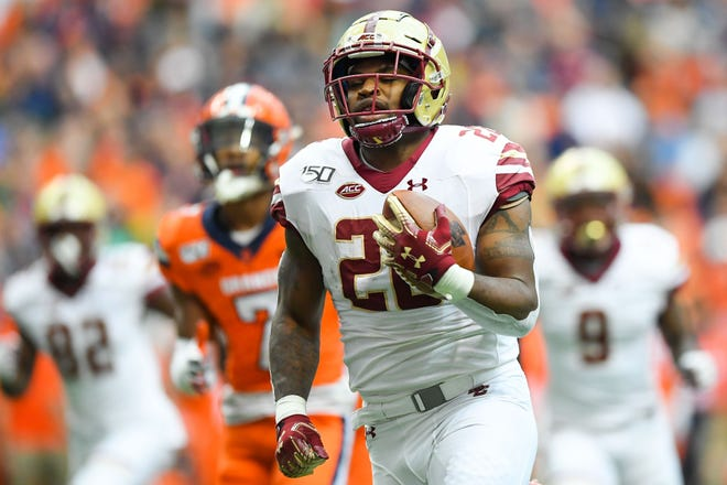 Boston College running back David Bailey, shown running for a touchdown in a Nov. 2, 2019, game at Syracuse, has transferred to Colorado State for his final two seasons of eligibility, a CSU athletic department spokesman confirmed.
