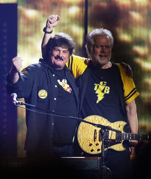 Burton Cummings, left, and Randy Bachman, shown here in 2005, will reunite for their first round of U.S. dates in more than a decade this summer.