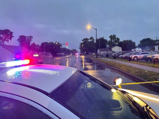 An Indianapolis Metropolitan Police Department police car blocks off a street after officers were called to the3200 block ofSouthKeystone Avenue south of East Troy Avenue on a report of a person shot before 6 a.m. Wednesday, June 2, 2021.
