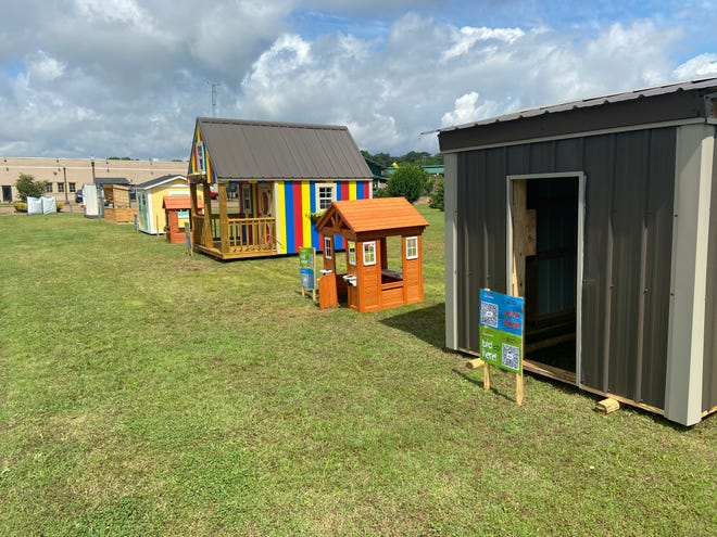 Seven playhouses sit on Lafayette Street between Highland Avenue and Shannon Street in Habitat for Humanity's Playhouse Build fundraiser.