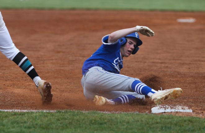 Oldham County's Deaton Oak (22) slid safely into 3rd against North Oldham during the 29th District championship at the South Oldham High School in Crestwood, Ky. on June 1, 2021.  Oldham County held on to defeat North Oldham 7-5.