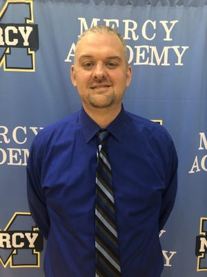 Nick Cann has been named the basketball coach at Mercy Academy.