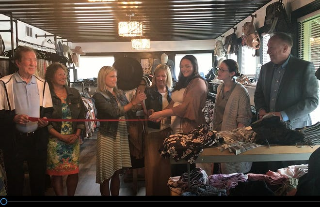 The owners of Olive & Oak Company, 271 Cline Ave., Wednesday celebrated a grand opening with Richland Area Chamber of Commerce and Economic Development at the new women's clothing and accessories boutique. Owners are Sam Klupp, center, her mother-in-law Amy Klupp and Jessica Klupp, holding the ribbon.