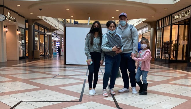 Laura and Michael Martinez Bravo with their children at Mayfair Mall.