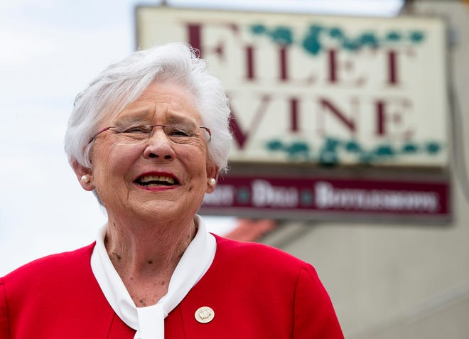 Alabama Governor Kay Ivey talks with the media at Filet & Vine in Montgomery, Ala., as she makes her first campaign stop on Wednesday June 2, 2021. Ivey announced that she is running for re-election as governor on Wednesday morning.