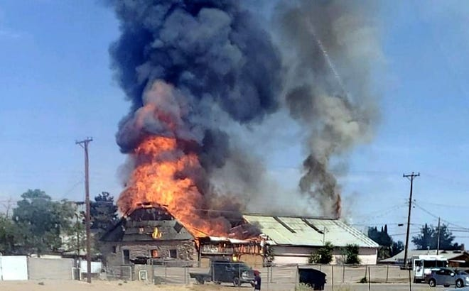 Stitch Concepts, at 304 E. Hemlock St., went up in flames and thick smoke on Wednesday morning. Deming firefighters used a pump truck and ladder truck to battle the blaze that burned a warehouse and workshop at the custom upholstery business.