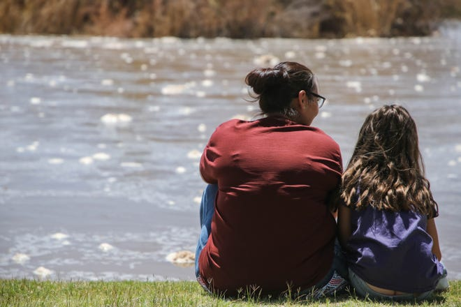 Sonya Adams and her family watch the Rio Grande flow at La Llorona Park in Las Cruces on Wednesday, June 2, 2021.