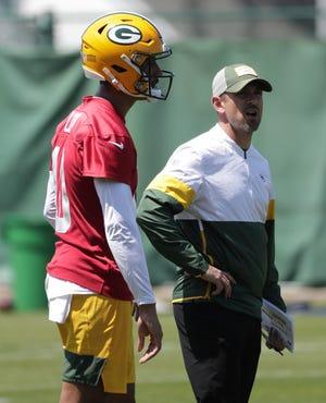 Green Bay Packers quarterback Jordan Love (10) and head coach Matt LaFleur participate in organized team activities Wednesday, June 2, 2021, in Green Bay, Wis.