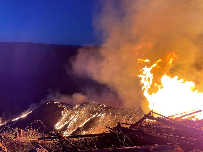 Crews battle a wildfire in rural Douglas County late Tuesday and early Wednesday.