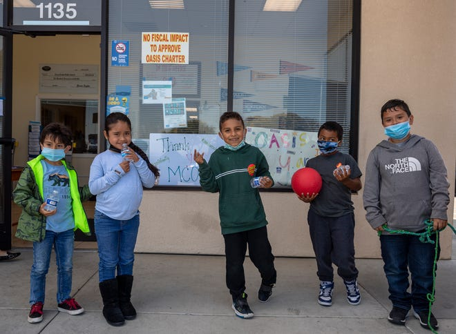 A group of first-graders line up in front of the main entrance at Oasis Charter Public School in Salinas, Calif., on Wednesday, June 2, 2021.