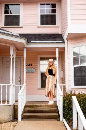 Mackenzie Howells purchased the Pink House of College Hills Boulevard in January in preparation to expand the Silo Salon & Wellness Spa.