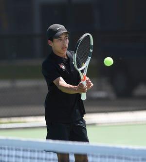 Tech senior Emilio Estevez volleys the ball Wednesday, June 2, 2021, at Sartell High School.