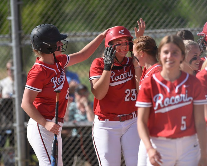 ROCORI first baseman Shelby Prom is mobbed by teammates after a two-run home run in the first inning Tuesday, June 1, 2021, in Cold Spring.
