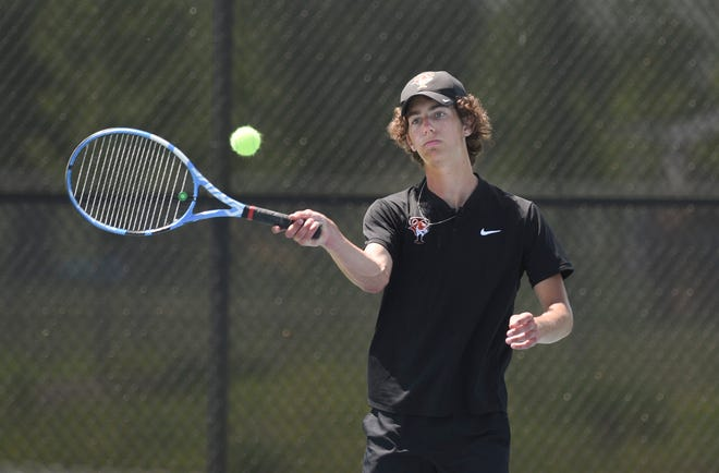 Tech sophomore Gavin Fenstad hits a shot Wednesday, June 2, 2021, at Sartell High School.