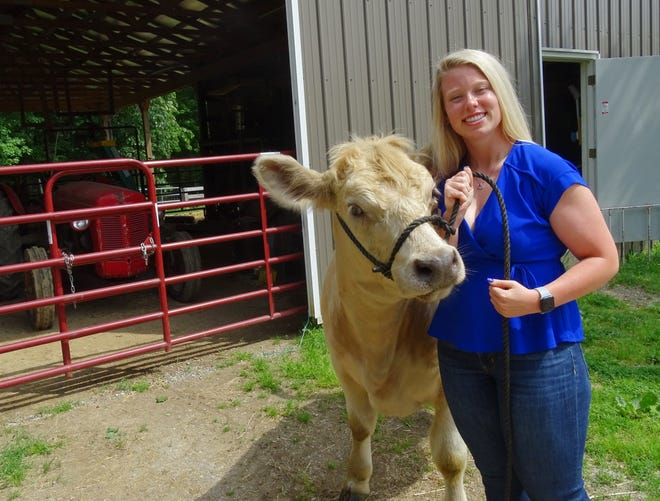 Recent Philo High School graduate Lauren Lyon with her cow, Mist. Lauren, who graduated in spring of 2021, has shown steer from her family's Philo farm at 4-H competitions since she in grade school.