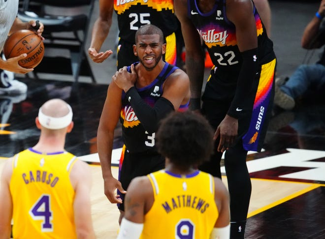 Suns guard Chris Paul reacts after suffering an injury during Game 5 against the Lakers.