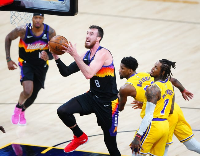 First round: The Phoenix Suns' Frank Kaminsky (8) drives to the basket against the Los Angeles Lakers during Game 5 at Phoenix Suns Arena. The Suns won the game, 115-85, to take a 3-2 series lead.