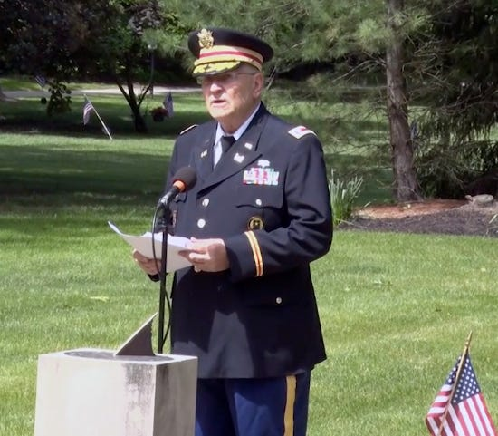 In this image captured from Hudson Community Television, retired Army Lt. Col. Barnard Kemter gives a Memorial Day speech in Hudson.