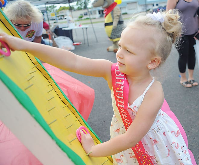 """Jayana Mathies, 4, celebrates her birthday Tuesday, June 1, 2021, with a turn at the game """"Plinko"""" during a Kickoff to Summer Carnival at Texas Roadhouse. Jayana wore a sash reading """"Birthday Girl"""" to announce it was her special day."""