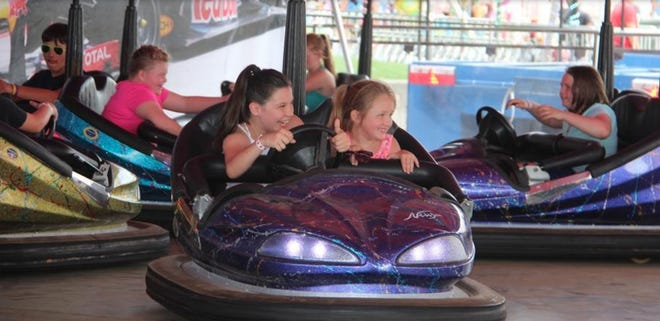 Anya Scott and Kaylee Hanks ride the bumper cars during the 2017 National Sand Bass Festival.
