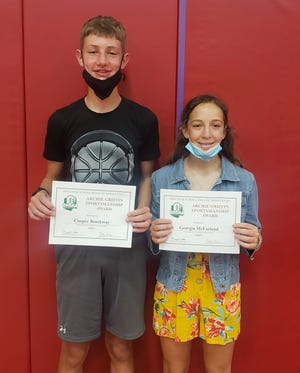 Crestview Middle School students Cooper Brockway and Georgia McFarland pose for a picture after receiving the Ohio High School Athletic Association's Archie Griffin Sportsmanship Award.