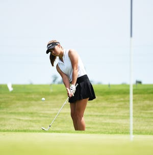 Kate Rahfeldt, seen her chipping a shot onto the 18th green during Tuesday's opening day of competition, was medalist runner-up to help Roland-Story finish second as a team during the Class 2A girls' state golf meet Tuesday and Wednesday at the American Legion Golf Course in Marshalltown.