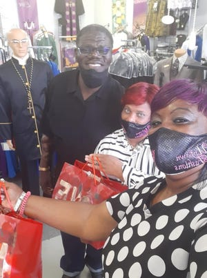 Curtis Capers and Vikki Lewis have two businesses under one roof: The Clergyman's Closet & Uptown Fashions.