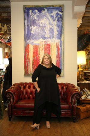 """Sue Meitner, president of Centennial Lending Group, hosts local stories for the television show, """"Financing the American Dream."""" She is pictured in Of Iron & Oak, a furniture store in Lambertville, New Jersey, that she included in a segment on housing in the New Hope area."""