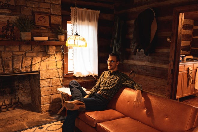 Musician Jack Settle relaxes in his cabin south of Nashville.