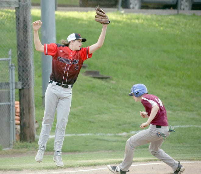 Prairie Home third baseman Peyton Pitts leaps in the air for the ball while attempting to tag the runner for Imhoff's Appliances attempting to steal in the first game Wednesday night in Junior Babe Ruth at Twillman field in Harley park.