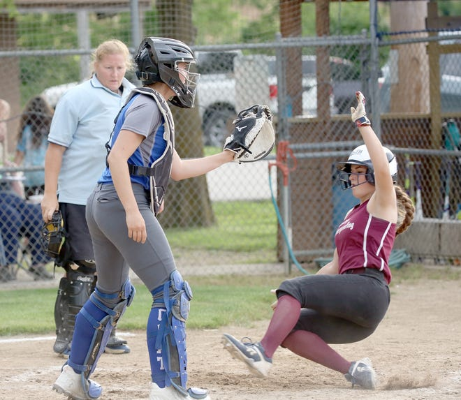 Custom Weatherproofing's Cora Thompson slides at home plate against Rick Ball in Babe Ruth 16Usoftball Wednesday night at Bill Simmons field at Rolling Hills park.