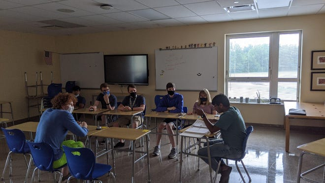 The Olentangy Berlin High School quiz bowl team practices during the school year. Pictured from left to righ: Ruarui O'tighearnaigh, Aditya Arora, Simon Zimmerman, Ryan Pocius, Aidan Jeansonne, Cassidy Disantis and Adithya Nair. The Bears placed 159 out of 224 schools in the National Academic Quiz Tournament High School National Championship.