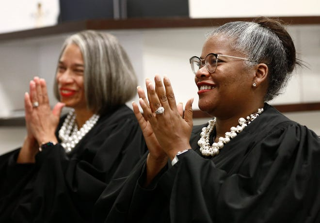 Franklin County Domestic Relations/Juvenile Court Judge Terri Jamison, left, and 10th District Court of Appeals Judge Laurel Beatty Blunt applaud one of the speakers during a virtual swearing-in ceremony for Jamison as a new appeals court judge on June 2. Jamison and Beatty Blunt are founding members of the recently created Ohio Black Judges Association.