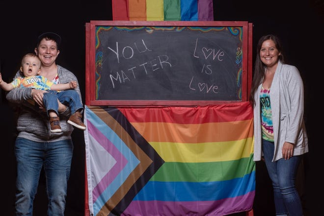 Heather Hoffman, left, poses for a photo with her wife, Danielle, and their 1-year-old son, Bennie, at Crooked Door Studio in Marysville in anticipation of Saturday's inaugural Marysville Pride Fest.