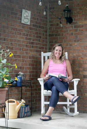 Mackenzie White of Hilliard spent much of the pandemic reading on her porch or in her backyard. She was hopeful for the day when normalitywould return but found that emerging from lockdown wasn'tas easy as she expected.