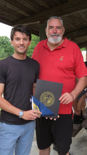 N.C. Rep. Jon Hardister presented Joel Leonard, of Asheboro, with a North Carolina state flag that had been flown over the state capitol building in his honor.